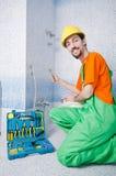 Idraulico che lavora nella stanza da bagno Immagine Stock Libera da Diritti