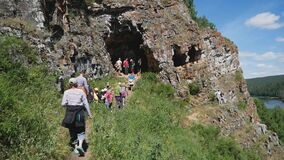 Idris Cave, Russia - June 12, 2020: vacationing families on a holiday came to visit the caves