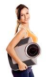 Idrotts- flicka med en scale arkivfoto