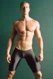 idrotts- male muskulöst Arkivbild