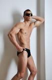 idrotts- manpacke sex Arkivfoto