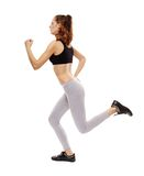Idrotts- ung kvinna som gör att jogga Royaltyfri Bild
