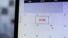 Idrottshall planlagd i online-kalender på datoren, aktiv utbildning, sund livsstil lager videofilmer
