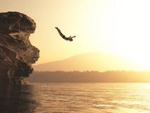 Idrottsman nen hoppar in i en sjö royaltyfria bilder