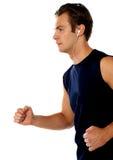 idrottsman nen som tycker om rustande musikställing för fit Arkivbilder