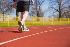 Idrottsman på löparbanan Arkivfoton