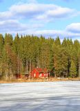 Finland, Savonia: Cabin at a Frozen Lake Royalty Free Stock Photo