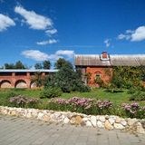 Idyll. House in ancient Kremlin in small town with well-kept garden Royalty Free Stock Image