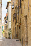 Idyllic alley. In a small Italian village Royalty Free Stock Images
