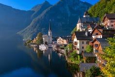 Idyllic alpine lake village Hallstatt, Austria. Wooden houses and stone church on idyllic alpine lake village Hallstatt, Austria Stock Images