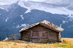 Wooden cottage in dolomities alps Italy. Idyllic alpine mountain scenery with traditional old mountain wooden cottage in Seceda peak, Dolomiti. South Tyrol Royalty Free Stock Photo