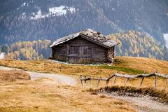 Wooden cottage in dolomities alps Italy. Idyllic alpine mountain scenery with traditional old mountain wooden cottage in Seceda peak, Dolomiti. South Tyrol Stock Images
