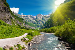 Idyllic alpine valley in sun rays. Royalty Free Stock Images