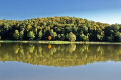 Idyllic autumn reflections on lake surface Stock Photo