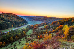 Idyllic Autumn Scenery. With Colorful Orange Golden Trees near a lovely Country Road in the rocky Jura Mountains of Bavaria, Germany  Sunset in Fall with a Stock Photography