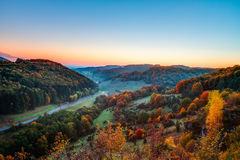 Idyllic Autumn Scenery. With Colorful Orange Golden Trees near a lovely Country Road in the rocky Jura Mountains of Bavaria, Germany.  Sunset in Fall with a Stock Photo