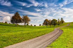 Idyllic autumn scenery on the golf course. Autumn landscape on the empty golf course Stock Photos