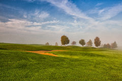 Idyllic autumn scenery on the golf course. Autumn landscape on the empty golf course Stock Images