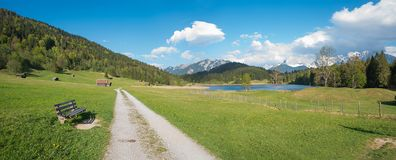 Idyllic bavarian landscape with walkway to lake gerold and bench Stock Photos