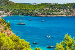 Idyllic bay with boats at Camp de Mar, Majorca Spain. Beautiful seaside view with boats at the coastline of Camp de Mar on Majorca Spain, Mediterranean Sea Stock Image