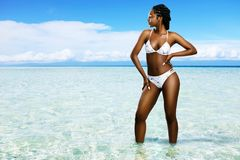 Idyllic beach with attractive black woman. Royalty Free Stock Images