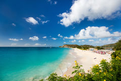 Idyllic beach at Caribbean. Idyllic tropical Darkwood beach at Antigua island in Caribbean with white sand, turquoise ocean water and blue sky royalty free stock image