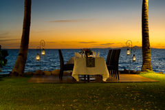 Idyllic beach front dining setting Stock Photo