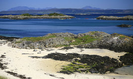Idyllic beach, turquoise sea and Skye, Scotland Royalty Free Stock Images
