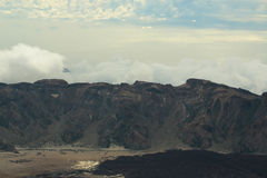 Idyllic black volcanic mountain tops and crater Royalty Free Stock Photography