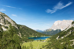 Idyllic blue mountain lake in austrian alps Royalty Free Stock Images