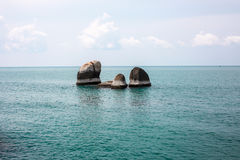 Idyllic blue sea and clear sky and bunch of stand-alone small ro. Cks in the middle of ocean. Taken in Koh Samui, Thailand Royalty Free Stock Photos