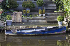 Idyllic boat near the house Royalty Free Stock Images