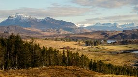 An idyllic car break in the Scottish Highlands. Trees & Mountains Royalty Free Stock Images