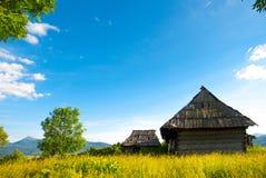 Idyllic carpathian chalet summer mountain meadow panorama carpat. Hian Royalty Free Stock Photos