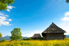Idyllic carpathian chalet summer mountain meadow panorama carpat. Hian Stock Images