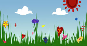 The idyllic cartoonish picture of a warm summer day. Spring Sunny meadow. Green grass with flowers against the sky. The idyllic cartoonish picture of a warm Royalty Free Stock Photos