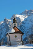 Idyllic chapel in wintry landscape Stock Photography