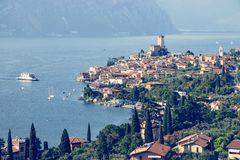Idyllic coastline scenery in Italy: Blue water and a cute village at lago di garda, Malcesine. Cute idyllic Italian village and lake captured from above royalty free stock photo