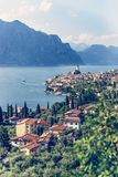 Idyllic coastline scenery in Italy: Blue water and a cute village at lago di garda, Malcesine. Cute idyllic Italian village and lake captured from above stock images