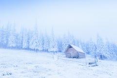 Idyllic cottage in winter Royalty Free Stock Image