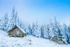 Idyllic cottage in winter Stock Photo