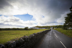 Idyllic Country Road After Rain. Road to Cushendun, County Antrim, Northern Ireland stock photos