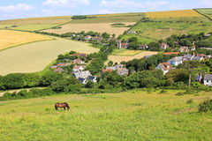Idyllic countryside with little village, surrounded by fields Royalty Free Stock Photography