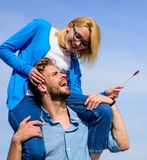 Idyllic date concept. Man carries girlfriend on shoulders, sky background. Woman enjoy perfect romantic date. Couple in. Love enjoy perfect date sunny day Royalty Free Stock Photography