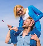 Idyllic date concept. Man carries girlfriend on shoulders, sky background. Woman enjoy perfect romantic date. Couple in. Love enjoy perfect date sunny day royalty free stock image