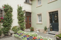Idyllic flower garden in city. Stock Images