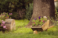 Idyllic garden with old wooden cart Royalty Free Stock Photos