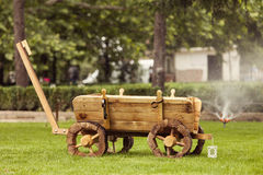 Idyllic garden with old wooden cart Stock Photography