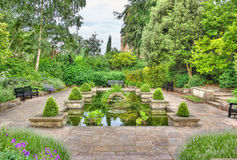Idyllic garden with pond Stock Images
