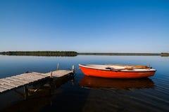 Idyllic Glassy Lake Landscape with Rowing Boat Royalty Free Stock Photos